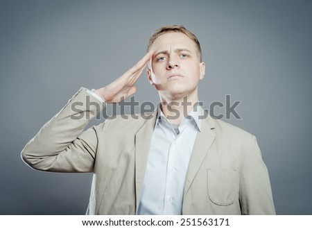 man salutes put his hand to his head - stock photo
