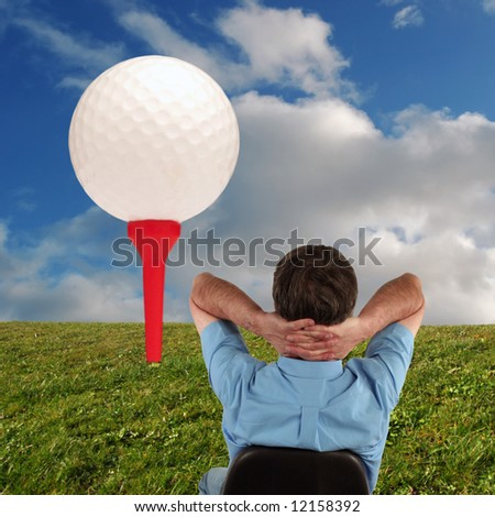 Man sat in chair dreams of his golfing vacation - stock photo