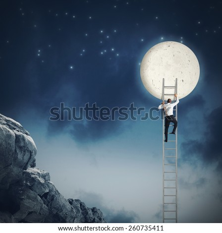 Man scale the sky because wants moon - stock photo