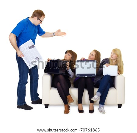 man scolds teenagers sitting on the couch with laptops - stock photo