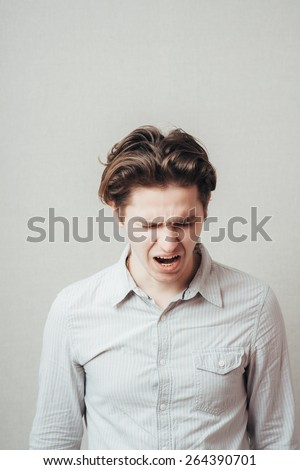 man screaming and looking down - stock photo