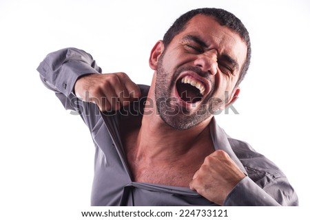 man screaming and ripping his shirt - stock photo