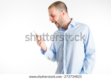 man screaming at phone - horizontal - stock photo