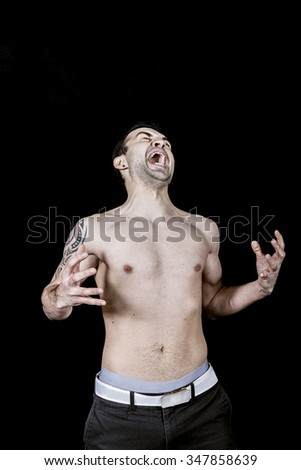 man screaming in pain topless - stock photo