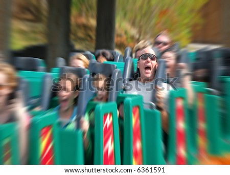 Man Screaming on Fast Roller Coaster with zoom blur - stock photo