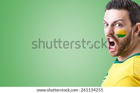Man screaming on green background - stock photo