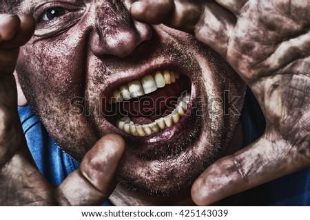 Man screaming scared in dark comic look - stock photo