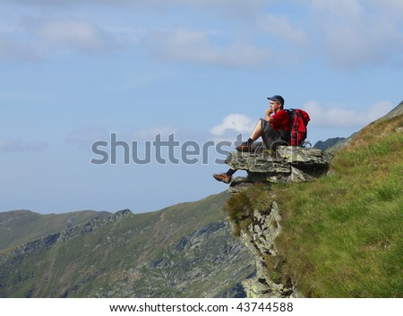 Man scrutinizing the horizon in mountains. - stock photo