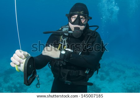 man Scuba diver in blue ocean - stock photo