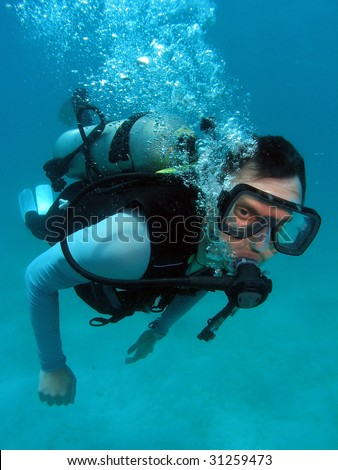Man Scuba Diving in Great Barrier Reef - stock photo