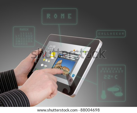 man searching a tourism information on touch pad