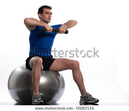 man seat on a swiss ball on a white background - stock photo