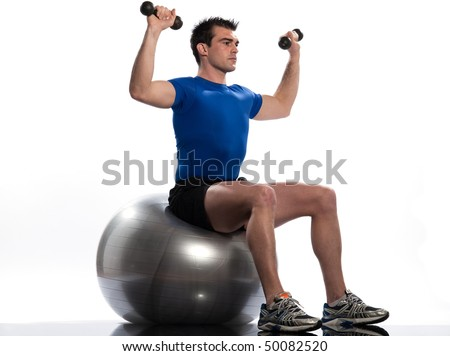 man seat on swiss ball. Seated Swiss Ball Upward Shoulder Rotation - stock photo