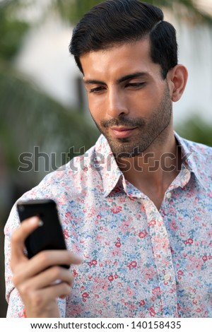 man sending or reading messages - stock photo