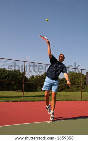 Man Serving Tennis Ball - 6 - stock photo