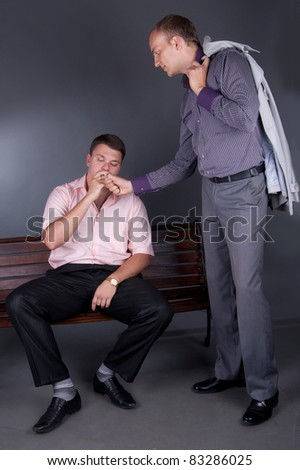 Man sets fire to a cigarette to a friend - stock photo