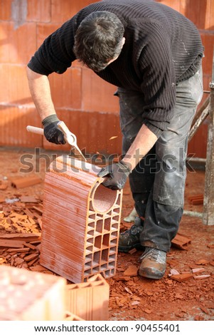 Man shaping a brick - stock photo