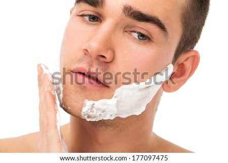 Man shaves his face - stock photo