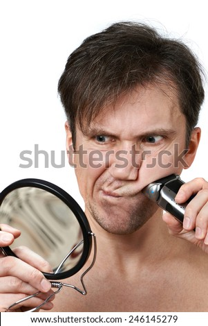 Man shaving face with electric razor on white background - stock photo