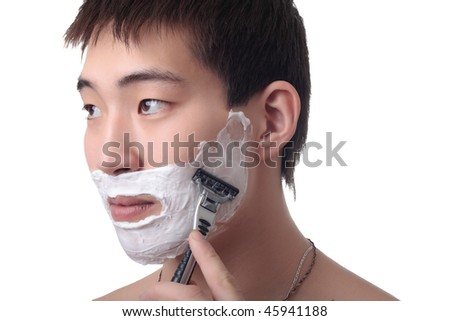 Man shaving his face on white background