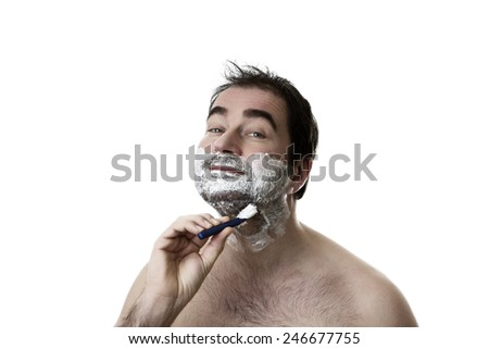 man shaving two week  of facial hair growth of his face - stock photo