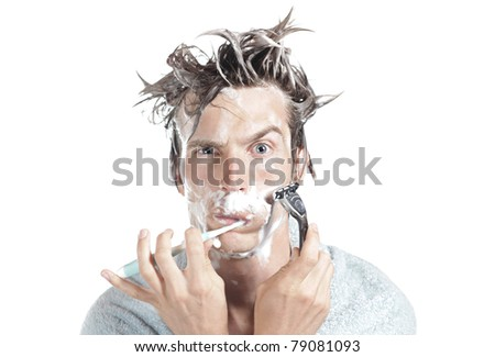 Man Shaving while brushing his teeth. isolated on white background