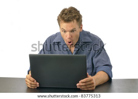 Man shocked at what he finds on laptop computer, isolated on white background