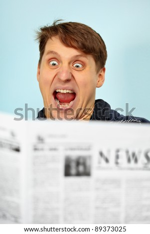 Man shocked by bad news from the newspaper - stock photo