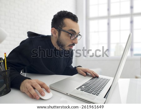 Man Shocked while working on computer in office  - stock photo