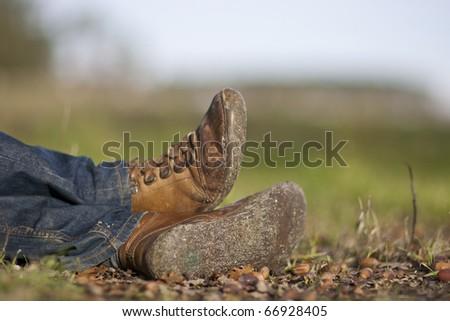 man shoes close-up in natural environment - stock photo