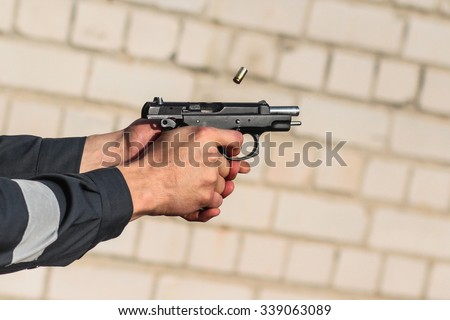 Man shooting a gun - stock photo