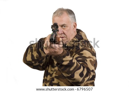 Man shooting at target with an air rifle with telescopic sights - stock photo