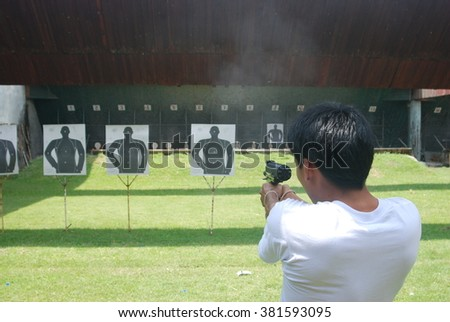 man shooting gun - stock photo