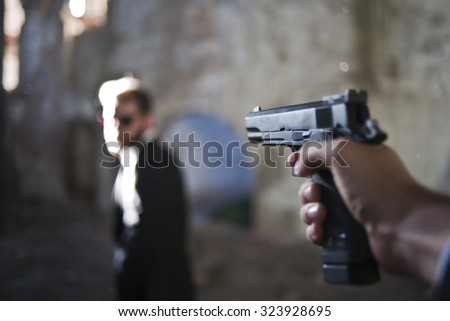 Man shooting to other - stock photo