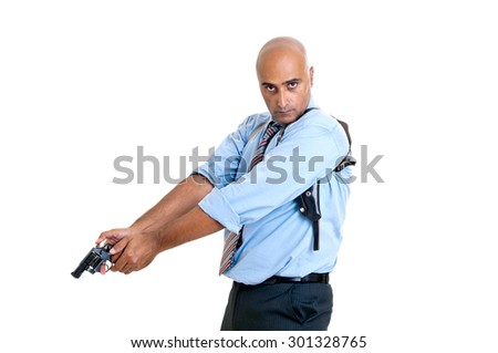Man shooting with gun isolated in white - stock photo