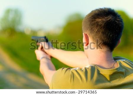 Man shoots at target. - stock photo