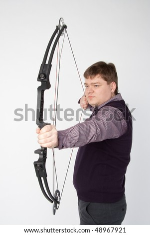 Man shoots compound bow. Isolated on white background