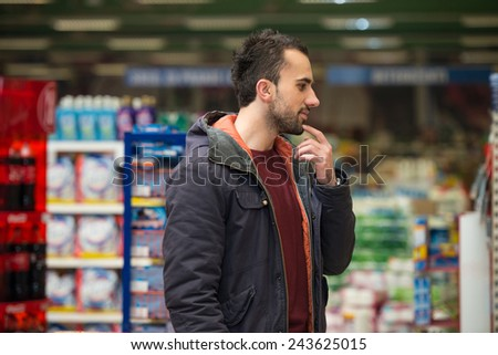 Man Shopping At The Supermarket - stock photo