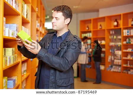 Man shopping for medication in a pharmacy