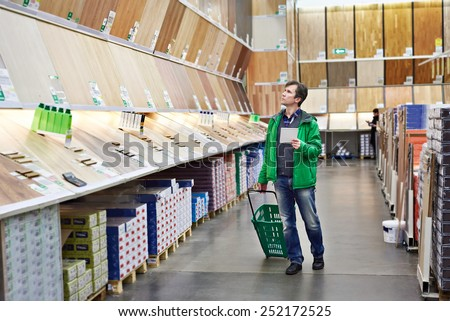 Man shopping laminate in DIY shop for construction - stock photo