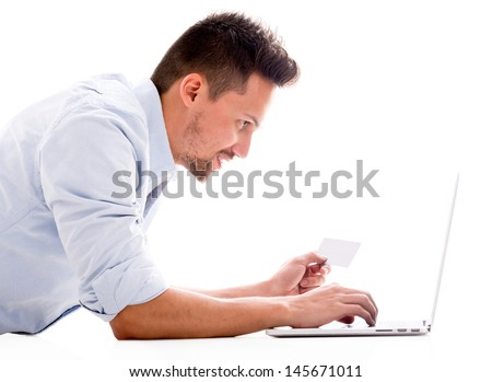 Man shopping online with a credit card - isolated over white - stock photo