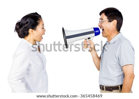 Man shouting at his partner through megaphone on white background