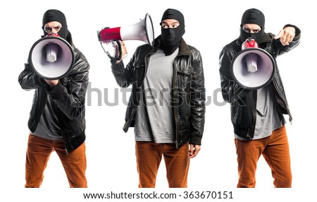 Man shouting by megaphone - stock photo