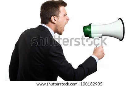 Man shouting in a megaphone. Isolated on white - stock photo
