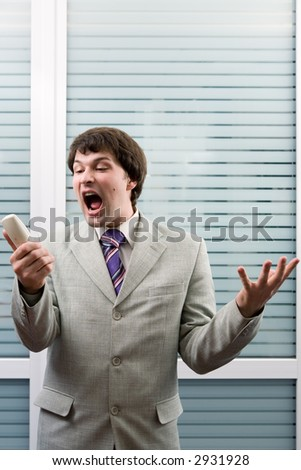 Man shouting on the phone in an office - stock photo