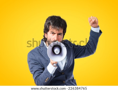 Man shouting over yellow background