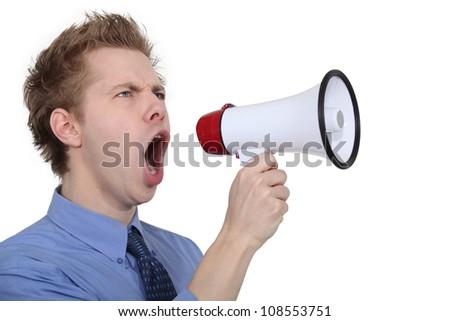 man shouting through a megaphone - stock photo