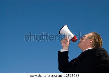 Man shouting through megaphone. - stock photo