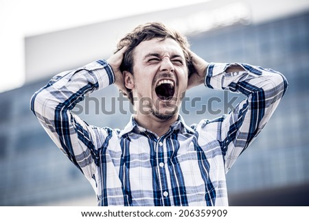 Man shouting with despair