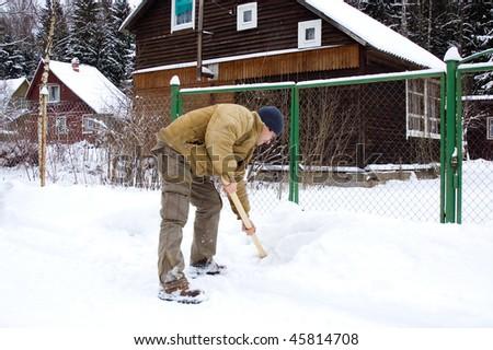 Man shoveling snow - stock photo